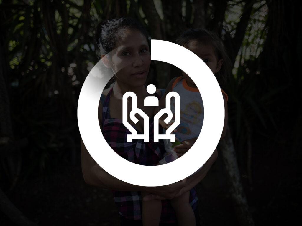 En symbol för humanitärt arbete på en mörk bild