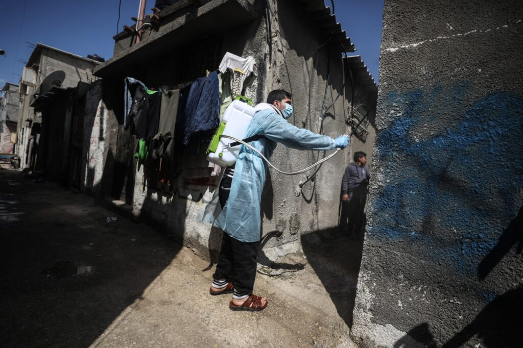 A health worker sanitising houses in a poor neighborhood in the Gaza Strip.