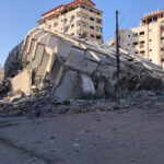 A collapsed building in the middle of the city.