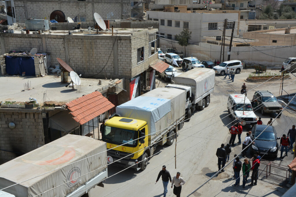 A convoy of trucks in a Syrian town.