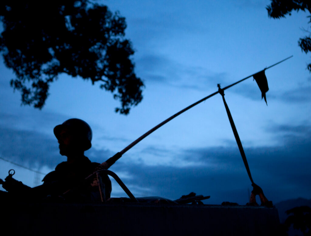 The silhouette of a soldier patrolling at night. Photo: MONUSCO/Sylvain Liechti