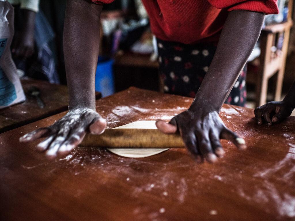 Two hands baking a dough