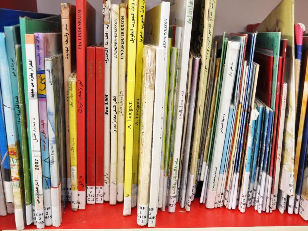 A photo of a lot of childrens' books in a shelf.