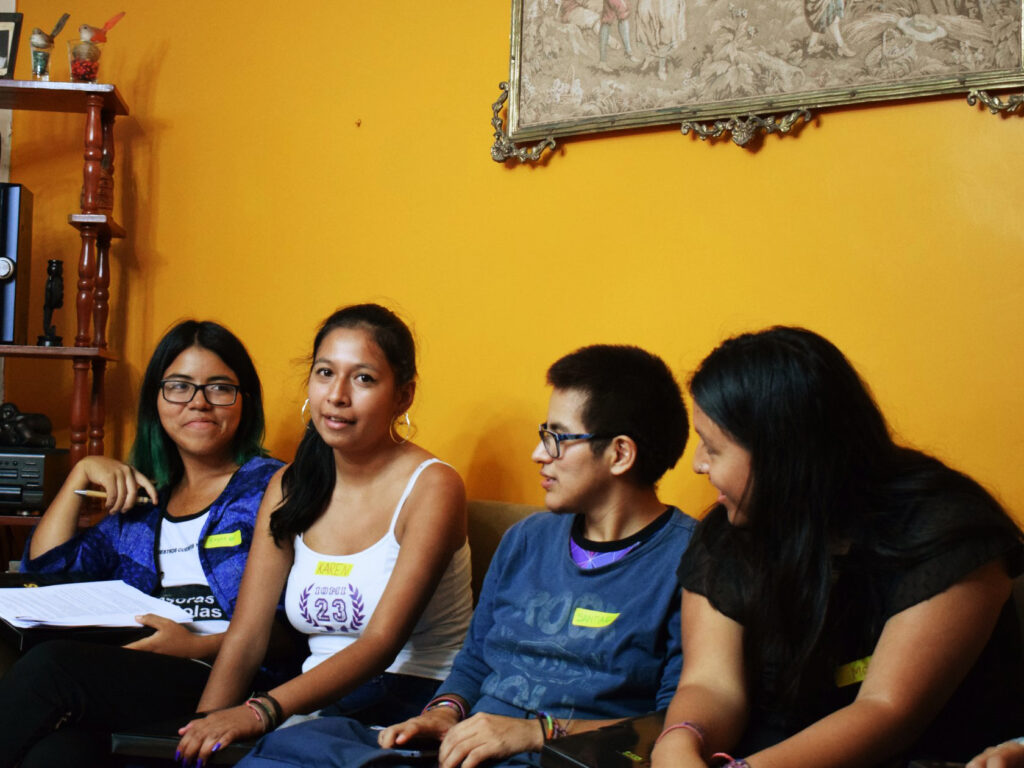 Young people sitting in a couch Peru