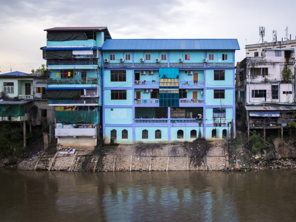 A view of a river and a house by the river